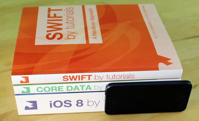 Side view of Swift by Tutorials, Core Data by Tutorials , and iOS 8 by Tutorials books.