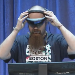 Unity's Pete Moss demonstrating the HoloLens during Unite's keynote.