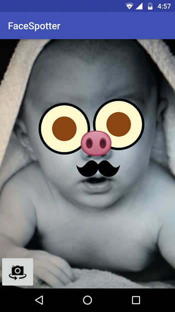 Augmented reality at work - cartoon faced baby